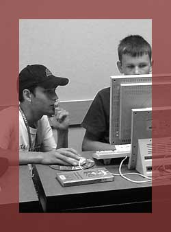 Program Evaluation: Student and instructor working at a computer.
